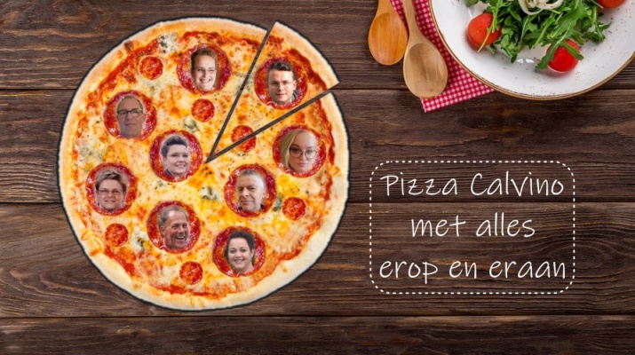 pizza met gezichtjes op houten tafel